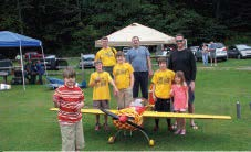 Cub Scout Pack 731 poses with a 40% JTEC Extra 300.